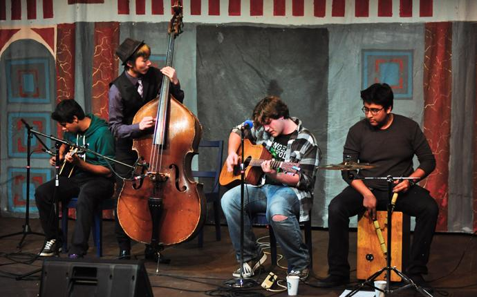 From left to right: junior Kieren Patel, seniors Wells Lucas Santo and Max Sorg, and junior Adi Nag, members of the local band Seventh Day Breakdown, perform an acoustic set at La Pluma's Coffee House on Jan. 20. According to organizer senior Sokena Zaidi, the Coffee House was created as a night of great performances to promote the literary magazine. Photo by Elvin Wong.