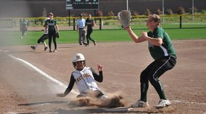 Girls softball: Strong defense holds off Mustangs 4-2
