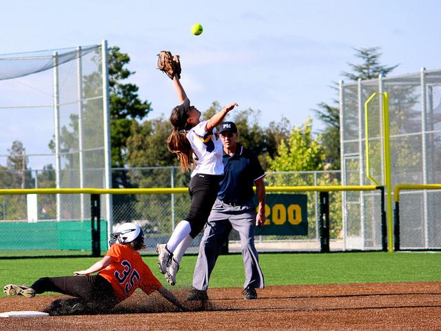 Sophomore Danielle Koontz leaps in to the air to catch a Los Gatos High School ball on May 20. Though the game was highlighted by strong MVHS catching, the team fell 9-3 to the Wildcats, severing their chances at a CCS championship. Photo by Justin Kim