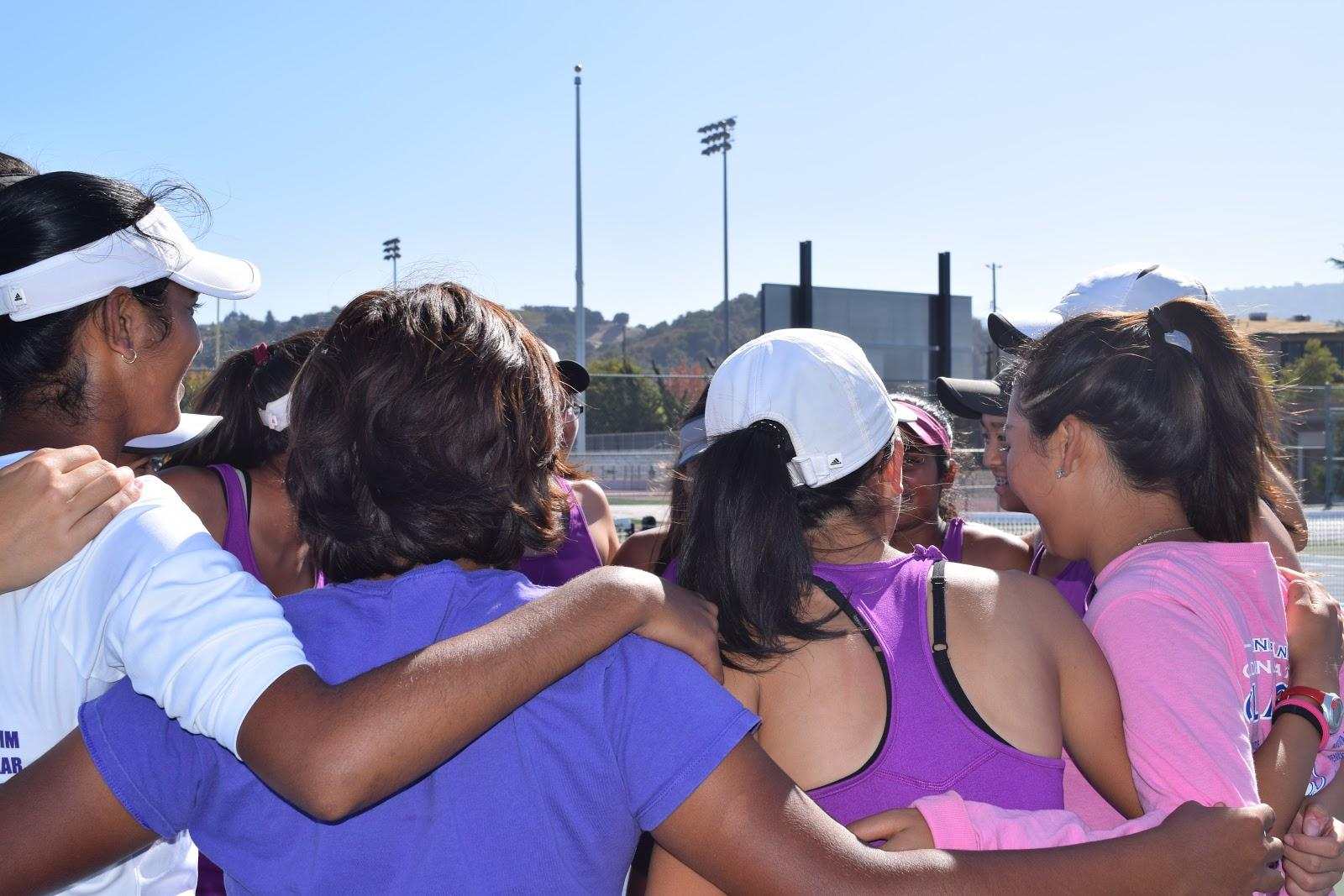 Team huddles together before the match.