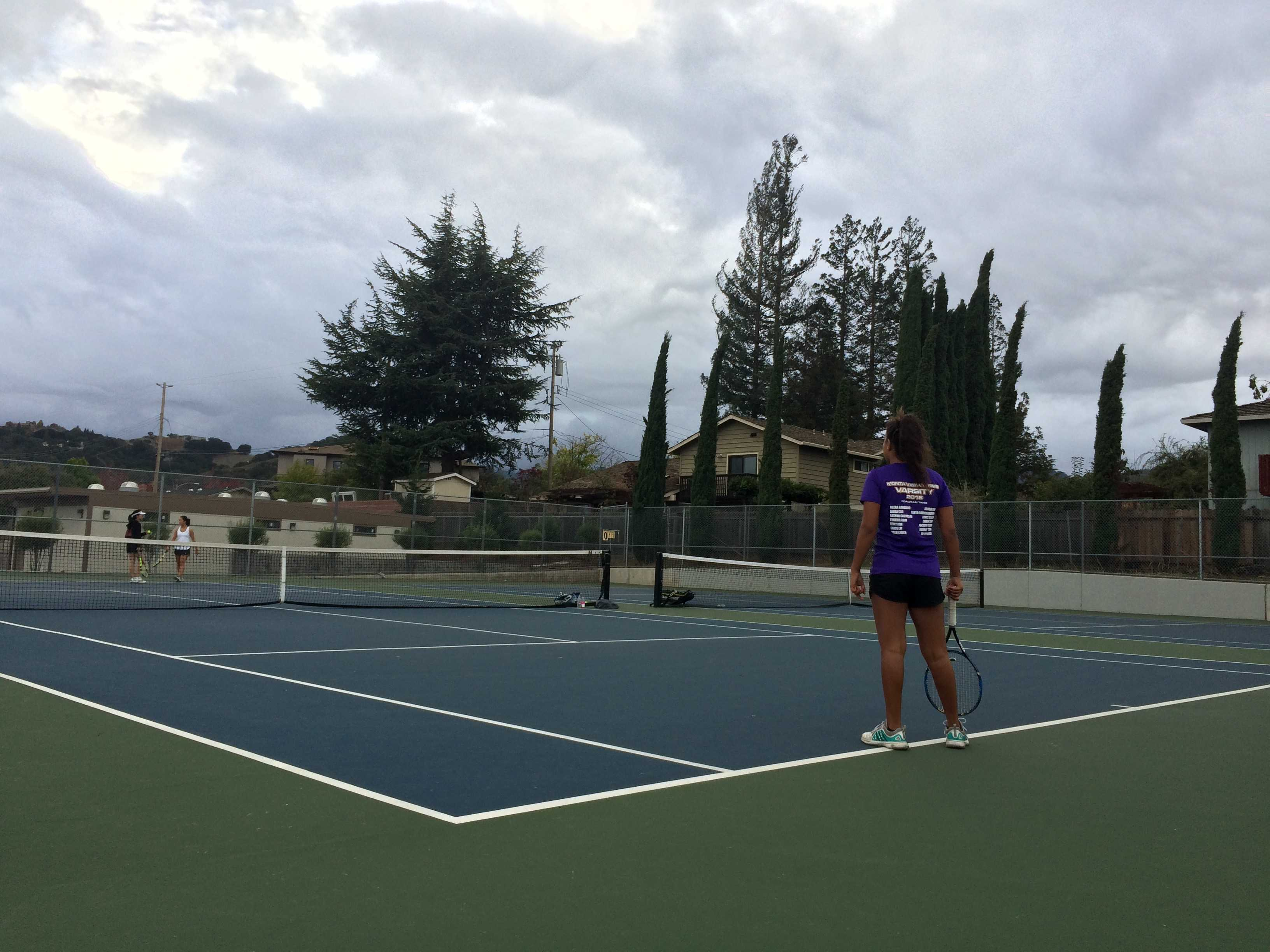 Freshman Meera Bamboo waits for her doubles partner, sophomore Tanya Ravichandran to serve.