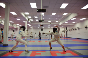 Sisters in arms: Anika and Aditi Soin participate in competitive fencing