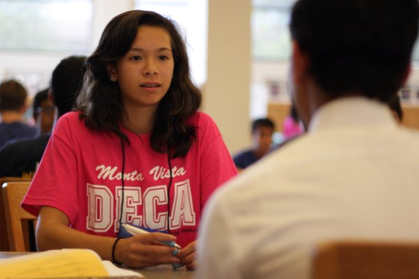 Freshman Natasha Shakouri practices a role-play with junior Alok Singh. Role-plays were a part of a curriculum that MVDECA designed to introduce incoming freshman to marketing.