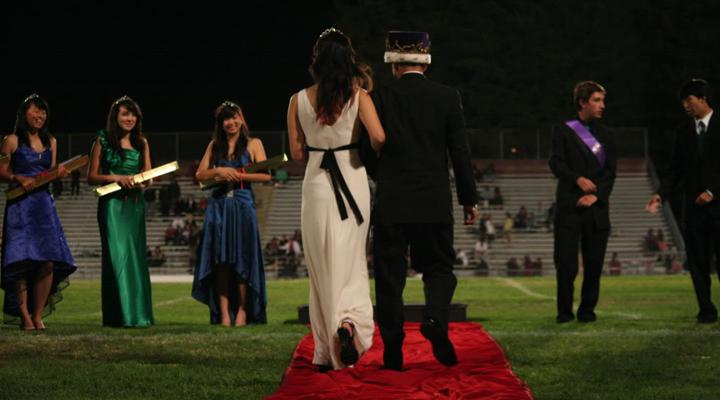 Class+of+2011+Homecoming+Court+members+Elaine+Tang%2C+Brianna+Zimmers%2C+Angeline+Chen%2C+Timur+Mertol+and+Jordan+Lim+wait+as+the+rest+of+the+court+arrives+onto+the+Cupertino+High+School+football+field.+This+year%E2%80%99s+Homecoming+King+and+Queen+will+be+announced+during+halftime+at+the+Oct.+14+Homecoming+football+game+at+Fremont+High+School.+Photo+by+Kevin+Tsukii.