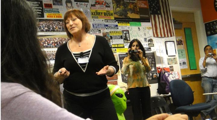"""New club plans Cambodian genocide presentation Photo Caption: Jenni Lipa, president and founder of Friends of Cambodian Child's Dream Organization (CCDO) Inc. speaks to a filled classroom on Oct. 21 about Cambodia's past and present. """"My main focus today is tolerance,"""" Lipa said. """"Genocide should really be a thing of the past."""" Photo by Karishma Mehrotra."""