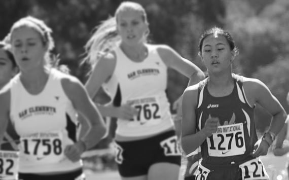 LEADING THE PACK: Freshman Jenny Xu runs in the Division I group of the Stanford Invitational cross country meet. Xu finished the 5-km course in seventh place with a time of 18:50.