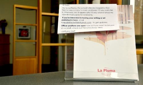 The current issue of La Pluma was distributed at the beginning of the 2011-2012 school year. The cover design and pages were all designed by senior Helen Han. Photo by Stephanie Chang.