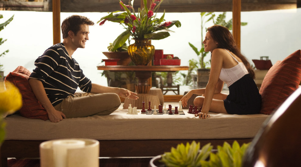 Robert Pattinson and Kristen Stewart return as Edward and Bella in Breaking Dawn Part 1. The series has improved with time, but still falls short at some crucial moments. Photo from Summit Entertainment.