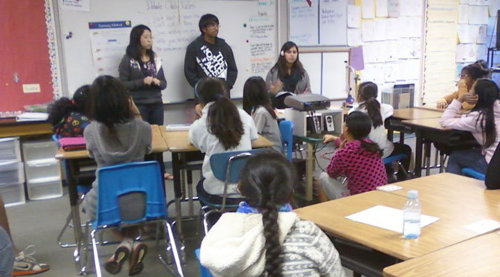 At the end of the Dec. 7 meeting, seniors Sokena Zaidi and Michelle Jiang and sophomore Ashutosh Jindal gather the Kennedy Middle School students to summarize the lesson on value criteria. Lincoln-Douglass debaters have begun teaching at KMS every Wednesday since the beginning of October to familiarize middle schoolers with LD concepts and critical thinking skills prior to entering high school. Photo by Lisa Zhang.