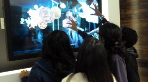FBLA members play with touchscreen televisions at the offices of Adobe Systems on Dec. 8. The business club regularly tours large companies to let members experience the workplace environment. Photo used with permission of Keshav Santhanam.