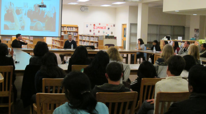 """Dr. Adam Dorsay answers questions during the Q&A session following the """"What Makes You Happy"""" seminar. The event, held on Feb. 13 in the library, was coordinated by PTSA member Kathleen McCulloch and had a total of about 60 attendees. Photo by Lisa Zhang."""