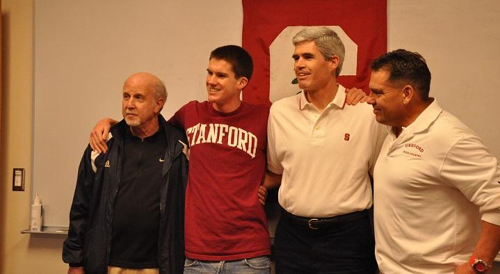 Senior Kevin Bishop stands with his father, Cary Bishop, and his coaches, Mike Dudley (far right)  and Willy Harmatz (far left). Kevin Bishop signed a contract to run for Stanford University's Cross Country team starting next fall in a small ceremony at the conference room of the office. Photo by Margaret Lin.