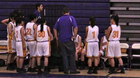 During a time out, the lady Matadors huddle while coach Sarah Borelli tells them the game plan.
