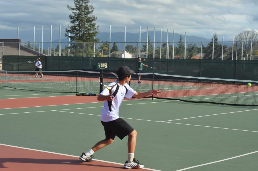 +Freshman+Jonathan+Li+readies+a+backhand+return.+Li+went+on+to+win+his+games+6-3%2C+6-1+and+contributed+to+the+team+score+of+6-1.+Photo+by+Kevin+Guo.+
