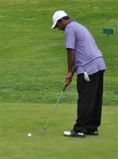 On March 15, senior Sujay Yantrapragada putts in his last hole of the game's nine-hole course. Yantrapragada ended with a score of 36, just four strokes more than the three best scores of the game. Photo by Daniel Tan.