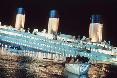 Lucky survivors flee on lifeboats while the rest of the passengers sink with the Titanic. Most of the casualties were men and third-class passengers. Photo taken from RW Entertainment.