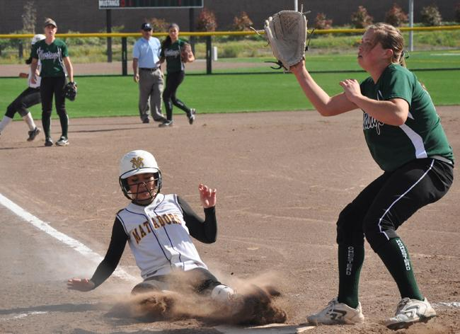 Senior Clarissa Wells slides into home on a wild pitch by Homestead pitcher junior Maddy Casto during the bottom of the second inning. Wells' run tied the score 2-2. Photo by Margaret Lin.