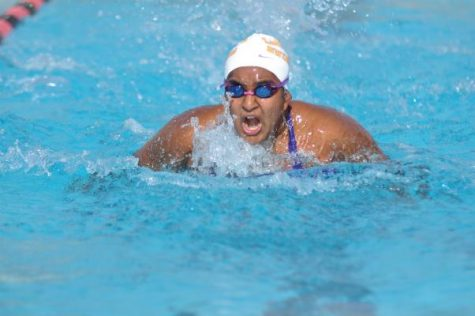 Senior Shravya Guda comes up for air during the 100-yard butterfly event. Guda finished with a final time of 1:29.78. Photo by Margaret Lin.
