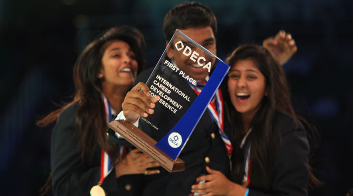 "(from left to right) Juniors Navya Cherukeru, Sanjeev Ranga and Pooja Pandey celebrate their first place victory during the DECA International Career Development Conference on May 2. DECA president Ansh Shukla credits the increase in first place wins to the change in the competitive training program. Instead of seeking out a veteran member to mentor them, new DECA members participate in classroom-like settings with an officer teaching basic concepts. ""The work and support the officers gave really gave us that extra push,"" Cherukeru said. Photo by Kevin Tsukii."