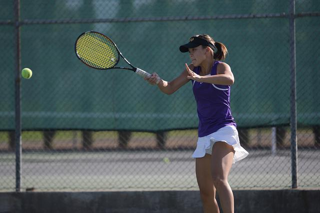 Senior Ruri Kobayakawa, then a junior, returns the ball during a game last season. Due to the great performance of the girls' tennis team last season, expectations are high as the girls enter yet another season. Photo from El Estoque archives.