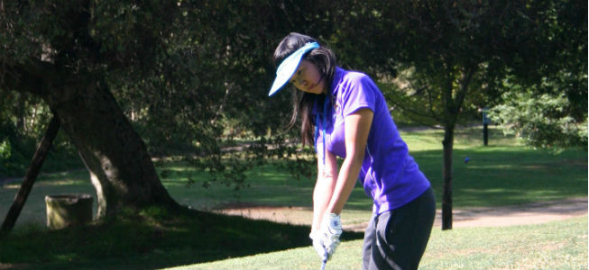 Sophomore+Valene+Tjong+attempts+to+putt+a+ball+into+the+fourth+hole+at+Cupertino%E2%80%99s+Deep+Cliff+Golf+Course.+Tjong+finished+with+a+score+of+55.+Photo+by+Karen+Feng.