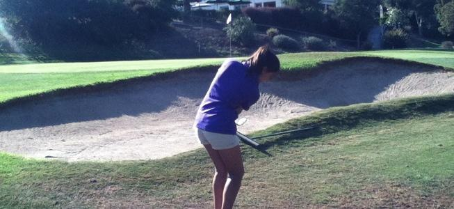 Captain senior Prianka Singh prepares to hit the ball over the bunker at Hole 8 on Oct. 30 at Cupertino's Deep Cliff Golf Course. She had the lowest strokes of the match with 35 strokes, just five over par. Photo by Alexandria Poh.