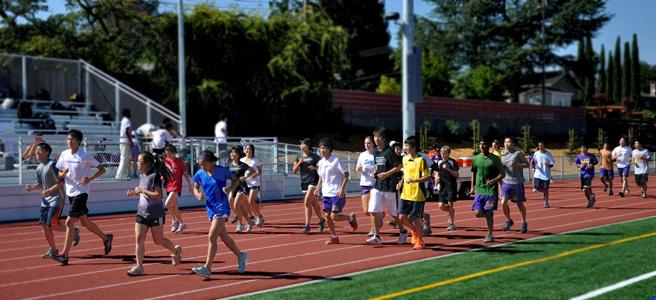 The cross country team practices after school on Sept. 11 on the new track. This year, head coach Kirk Flatow plans to implement pack running into the team's overall strategy. Photo by Margaret Lin.