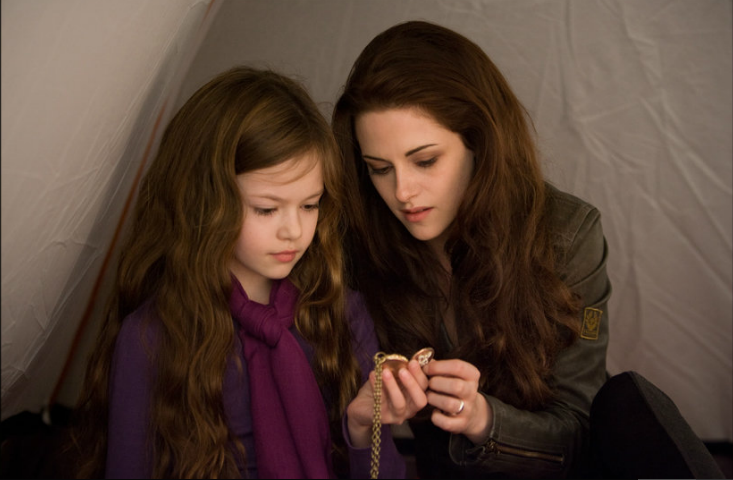"Bella (Kristen Stewart) comforts her daughter Renesmee (Mackenzie Foy) before clashing with the Volturi in ""Breaking Dawn Part 2"" directed by Bill Condon. The finale of the ""Twilight Saga"" has conviction and directorial charisma. Screenshot taken from Summit Entertainment."