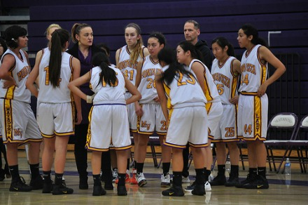 Coach Sara Borelli gives the Lady Mats a pep talk during half time, when they were trailing the Saratoga Falcons. Photo by Catherine Lockwood.