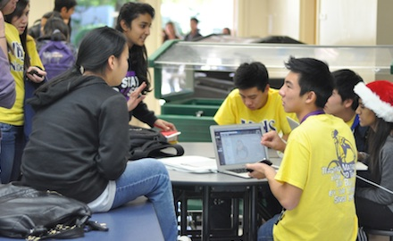 Junior Donovan Phua (right) chats with junior Karen Tseng at first day of the Link freshman finals study session on Dec. 3. All 120 Link Leaders have signed up to tutor freshman in preparation for finals, which begin Dec. 18. Photo by Margaret Lin.