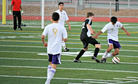 Defender senior Andrew Wang attempts to keep control of the ball on the MVHS side. The Matadors defeated the Cougars 8-0 in the second to last preseason game on Dec. 10. Photo by Carissa Chan.