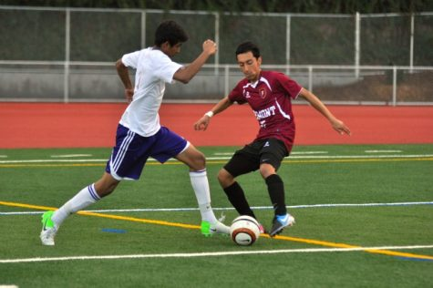 Midfielder senior Rohit Mukerji dribbles the ball past a FHS defender. The Matadors won 1-0, handing the Firebirds their first loss.