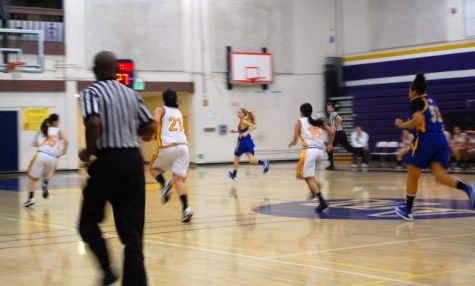Lady Mats race across the court to keep the Santa Clara Bruins from scoring. Photo by Catherine Lockwood.