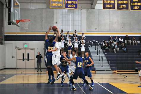 Junior Ramana Keerthi blocks a shot during Monta Vista's game against Santa Clara on Jan. 8. Despite a strong defensive effort, the Matadors lost 45-35 against the Bruins. Photo by Robert Sulgit.