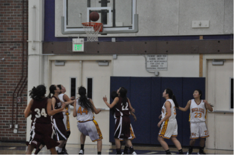 The Lady Mats eagerly anticipate the ball falling into the hoop shot from the three-point line. Photo by Athira Penghat.