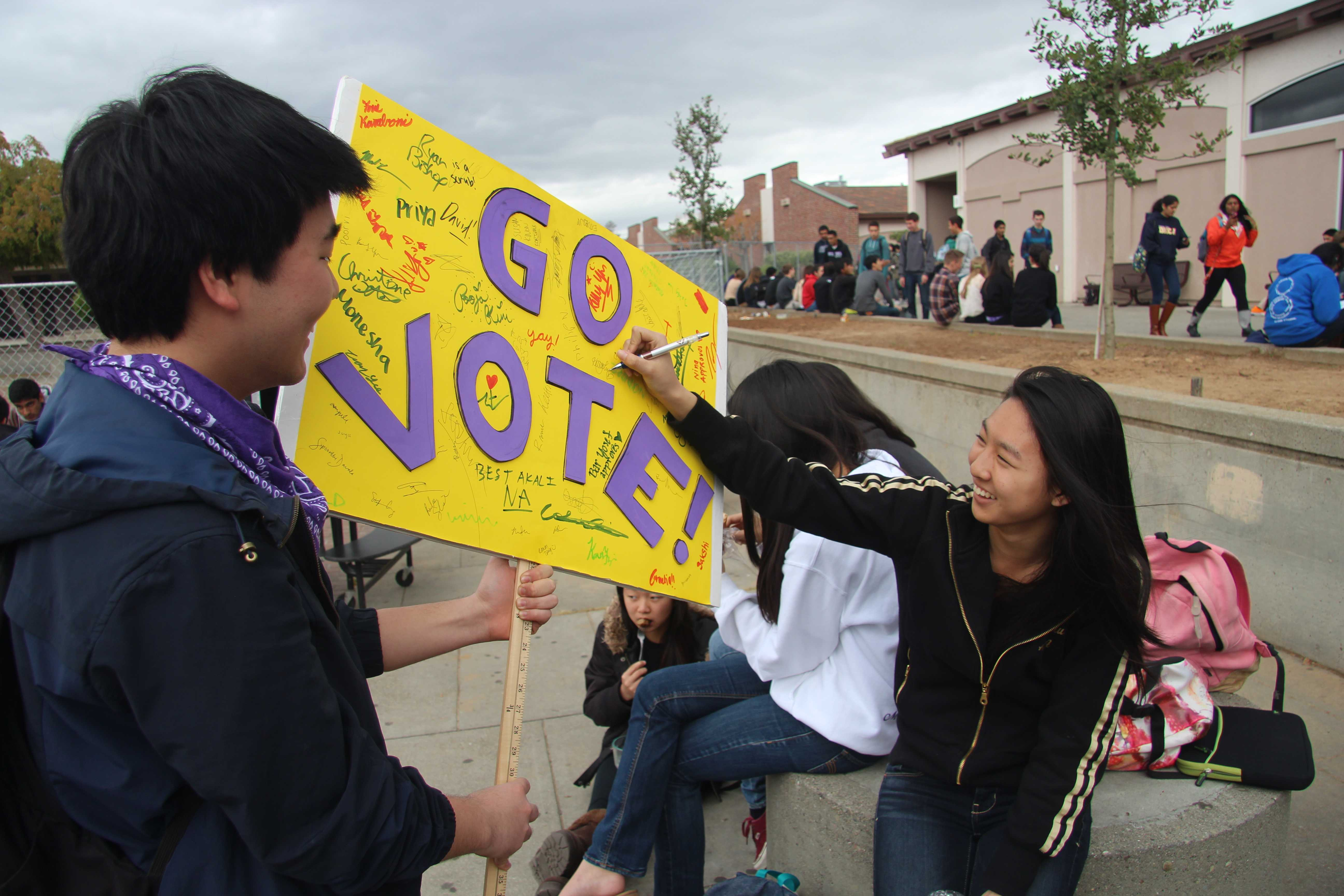 Junior Colin Kim allows students to sign his campaign poster. After three days of campaigning, ASB officers were announced on March 21. Photo by Mihir Joshi.
