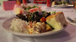 Each attendee received a full plate of food which included grilled meats, salad and grains. Drinks were also offered and the dessert was a slice of marble cake. Photo courtesy of Preston Yeung.