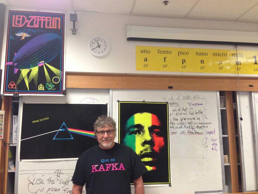 McCrystal stands in front of his posters, which depict Bob Marley, Led Zeppelin and Pink Floyd, some non-bands he listens to along with jazz. Photo by Joyce Varma.