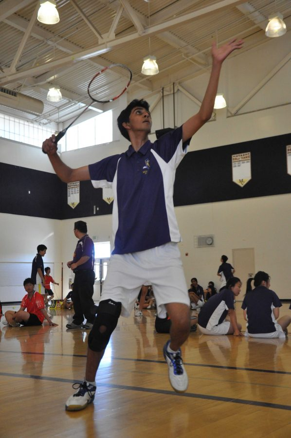 Junior+Anand+Kumar+set+up+for+a+smash.+Despite+a+slow+start%2C+Kumar+won+his+sets+15-8+and+15-3.+Photo+by+Margaret+Lin.