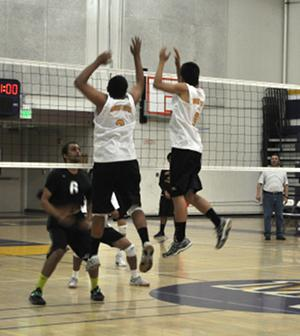 Seniors Atharva Fulay and Matthew Lem attempt to block a spike from Homestead High School on April 10. Although they won 3-1, the Matadors struggled with slow middle play, allowing Homestead to make a number of kills. Photo by Ruba Shaik.