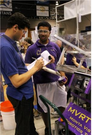 Engineering Lead senior Kumar Veeravel presents MVRT's robot to an awards judge at the Silicon Valley Regional on April 5. The team received the Team Spirit Award for its community outreach. Photo used with permission of Dennis Your.