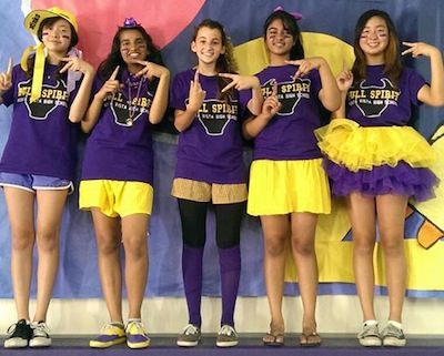 The 2017 class officers stand in front their class's rally poster at the Welcome Back rally. The officers were elected by students from their respective middle schools in May 2013. Used with permission of Lian Song.