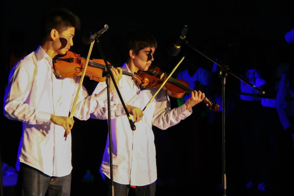 Juniors Michael Ligier and Andy Wang perform Britney Spears' 'Toxic' at last year's Blacklight Rally. Ligier and Wang go by the name No String Attached, and play popular songs on the violin. Photo used with permission of Clark Lin.