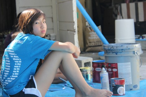 Sophomore Felicia Hou takes a break from the hand-painting the ocean.