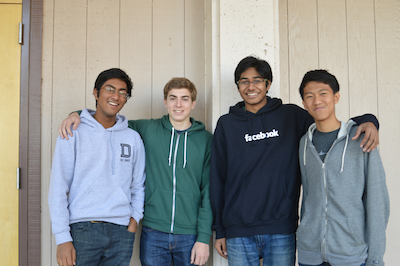 Sophomore Ajay Jain, seniors Michael Mattheakis and Zuhayeer Musa and sophomore Jimmy Liu (from left to right) won the Disrupt SF Hackathon 2013 last month. The boys created an app called Spruce, which allows users quick access to definitions while reading a book from its online library. Photo by Ashish Samaddar.