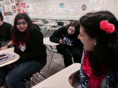 Senior Anisha Pathak talks to fellow club member junior Aditi Soin.