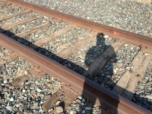 """It's my shadow self!"" said Jane. ""This is where I used to lay every morning."" Beneath the early afternoon sun, Jane bends over the railroad tracks that once haunted her."