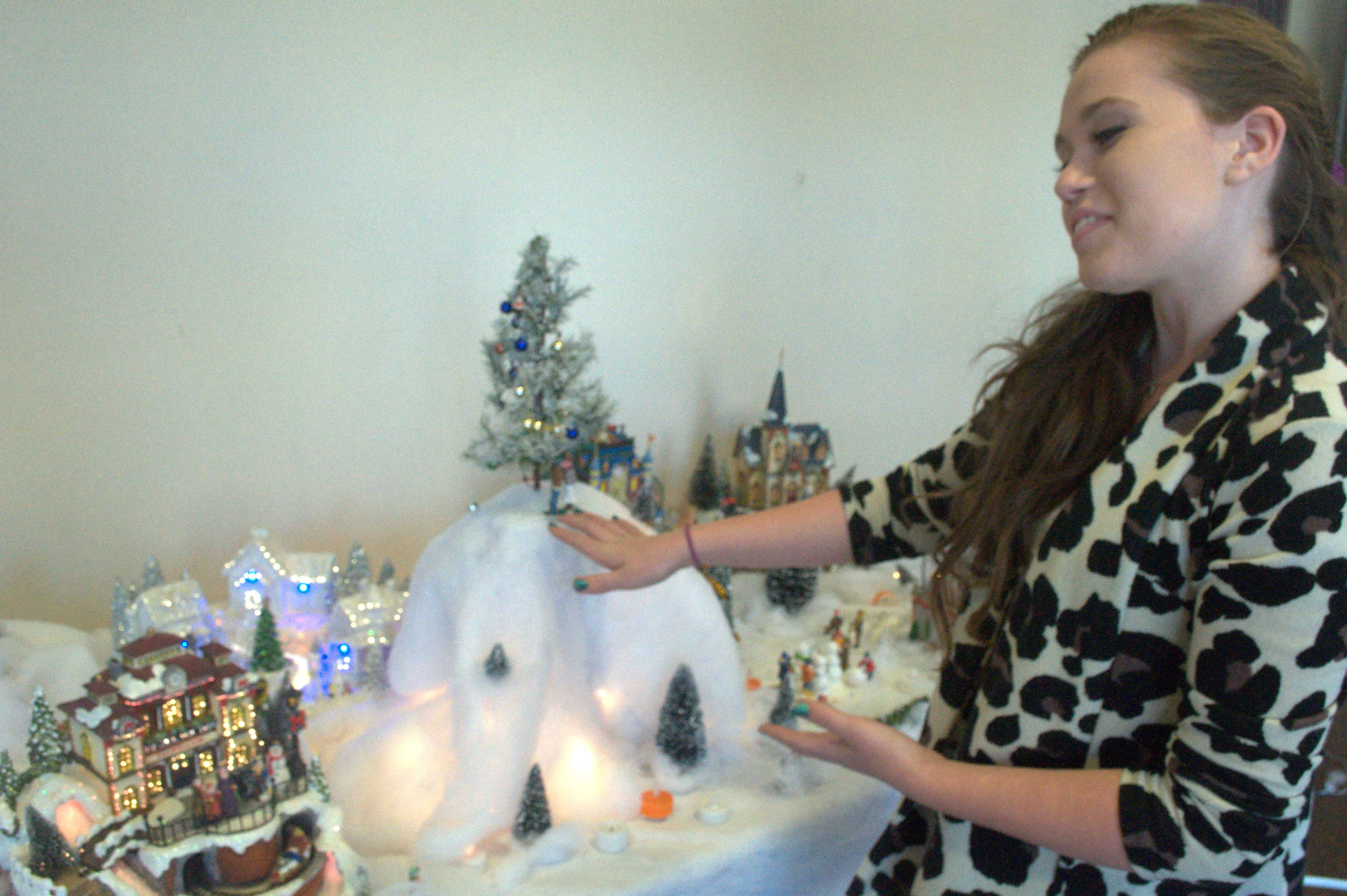 Sophomore Michaela Murphy exhibits her handiwork in the front lobby. Murphy and her Advanced Drama classmates crafted a miniature 3D diorama of the town of Almost, Maine. Photo by Yashashree Pisolkar.