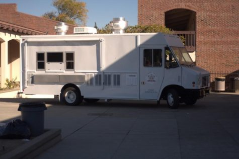 Food Services prepare for rain, tents or awnings to provide cover