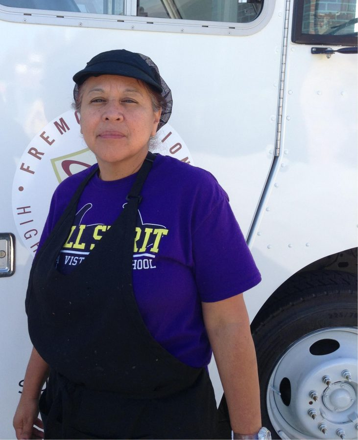 New Food Services supervisor Debbie Herrera stands in front of a food truck. Lunch is temporarily being served from the trucks while the cafeteria undergoes construction. Photo by Lydia Seo.